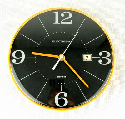 yellow orange Siemens Electronic wall clock front