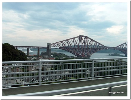 Firth of Forth rail bridge over North Queensferry. A cruise ship is berthed just around the corner.