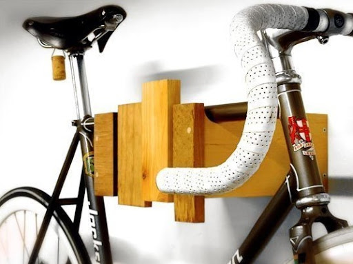 Cantilever and Press makes this bike rack out of reclaimed wood. (Cantilever and Press on etsy.com)