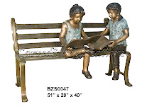 Boy and Girl Reading books on Bench