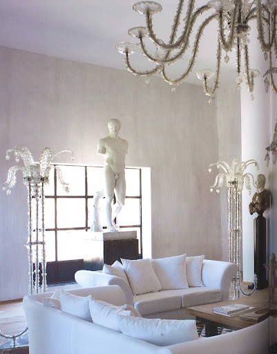 A chandelier and a set of floor lamps, all Barovier Venetian glass from 1949, surround sofas designed by Fremontier.(Dealer's Choice, Architecture/Interiors Press, Inc.)