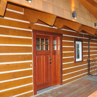 Entrance / porch of the Ecolog show home in Central Saanich with artistic railing