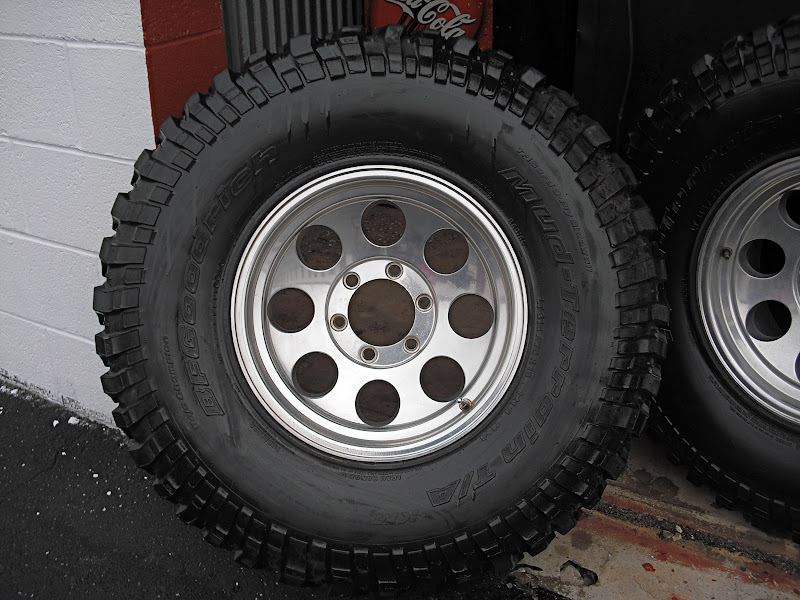 (4) 315/75R16 BFG MT KM's mounted on Pro Comp Xtreme Alloy ...