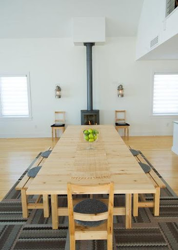 The long wooden table and benches remind me of a mess hall. (remodelista.com)