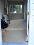 """The rough interior, with the lower """"genkan"""" style floor in the entryway"""