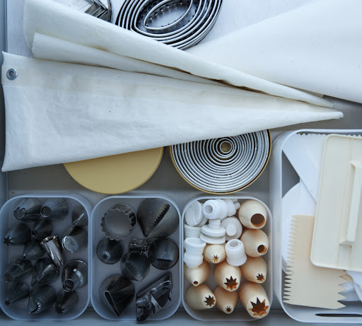 Cake decorating supplies are often easily lost or misplaced because they are small. Create a drawer just for them and place the smaller icing tips and frosting combs in plastic containers.