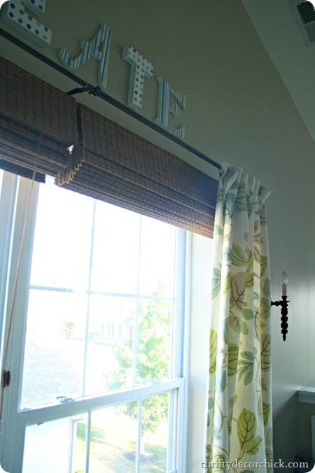 hanging roman shades above window