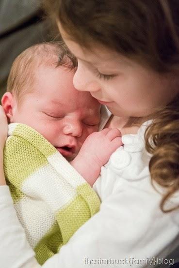 Abby holding sleeping Ethan blog-5
