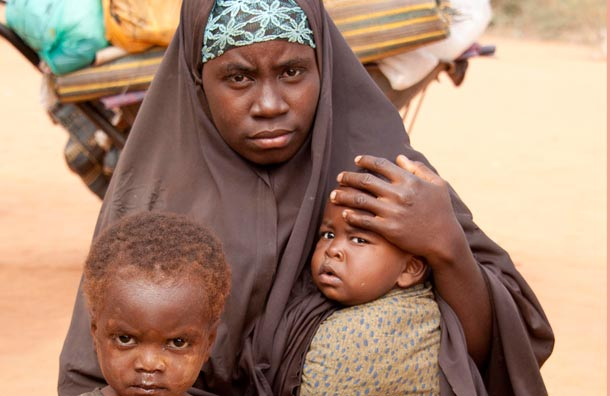 Somali refugee Hawa Muya, with son Hussein and daughter Fatma. Daily Mirror