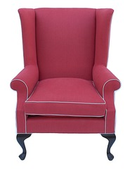 The rasberry color of this chair would liven and define a more classic space.