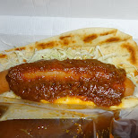 delicious curry sausage and nan bread from MOS burger in Tokyo, Tokyo, Japan