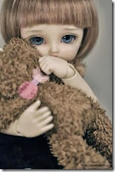Sad-doll-girl-alone-cute-with-teddy-hug