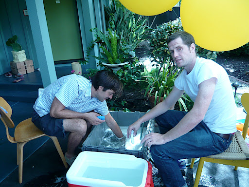 Everyone pitched in with clean-up. Here, a couple of friends do dishes after the big day.