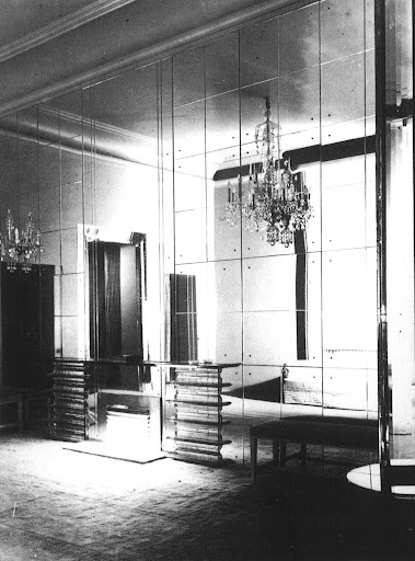 Fashion designers know better than anyone the importance of a glamorous backdrop to enhance one's image and Norman Hartnell was no exception. Hartnell's mirror-paneled salon proved that the Classical Moderne style was more than equal in luxury and elegance to traditional styles. (Regency Redux, Rizzoli)