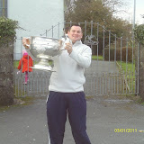 Puc Fada champion with a football trophy, Colin O Sullivan