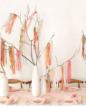 These simple fringe pieces are draped over branches and set in a clean, white vase for a more modern bridal shower table. (marthastewartweddings.com)