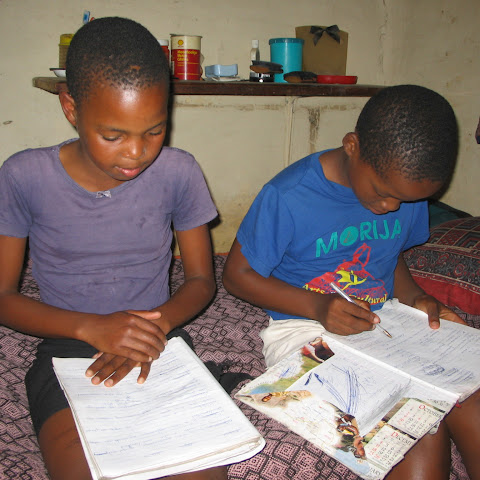 Then it's time for homework. Getting a good education is really important to them and so they do their homework together before going to bed.