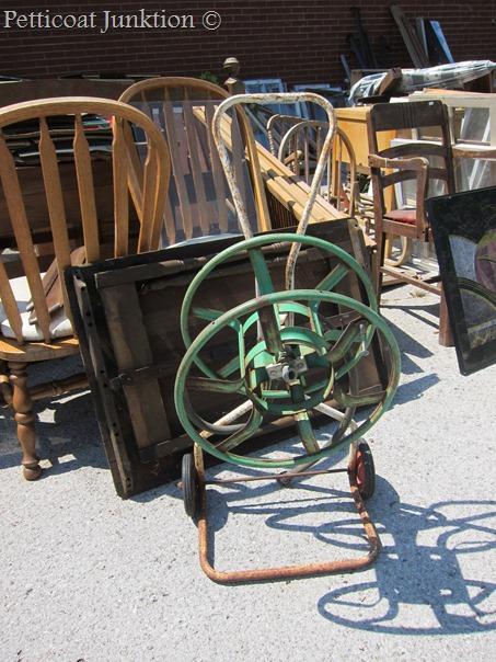 rusty-metal-garden-hose-reel-stand