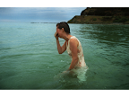 Helen Goodwin cries in relief after battling a seven-year depression; on Eastern Beach, Great Ocean Road. <em>© Simon O'Dwyer</em>