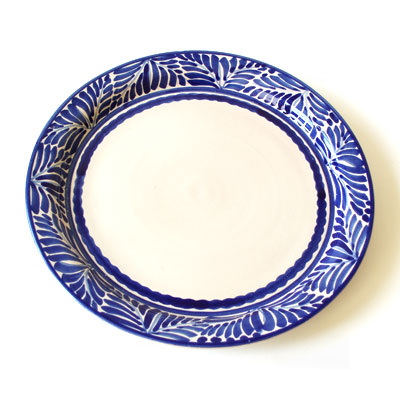 A colorful platter will add a simple and rustic charm to your table. (emiliaceramics.com)