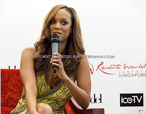 TYRA BANKS Supermodel IN SINGAPORE ASIA'S NEXT TOP MODEL America's Next Top Model creator, host executive producer EQUARIUS HOTEL RESORTS WORLD SENTOSA Carlos Miele bright yellow grey silk dress sky-high nude platform heels
