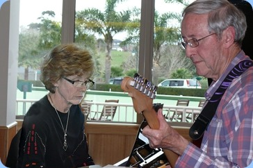 Musical passion and concentration personified! Denise Gunson on grand piano and Brian Gunson on electric guitar. Photo courtesy of Dennis Lyons.