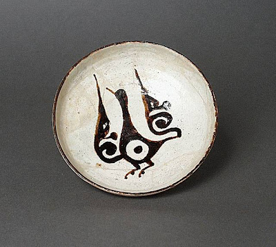 Plate Iran, Nishapur Plate, 10th century Ceramic; Vessel, Earthenware, white slip, slip-painted in black under a transparent glaze, 1 3/4 x 5 1/2 in. (4.45 x 13.97 cm) The Nasli M. Heeramaneck Collection, gift of Joan Palevsky (M.73.5.129) Art of the Middle East: Islamic Department.