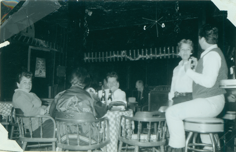 Patrons relaxing in Acme Bar. Circa 1961