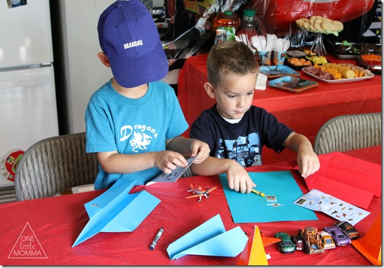 Make and decorate paper airplanes at a Planes themed party- #shop #WorldofCars