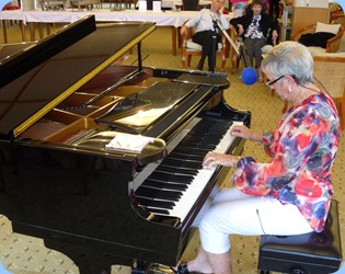 Our member from New Plymouth, Jeanette Harding, playing the grand piano and singing for the members and residents.