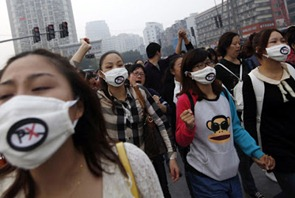 Protesters-shout-slogans-during-a-march-on-Sunday-against-plans-to-expand-a-petrochemical-plant-in-Ningbo-Zhejiang