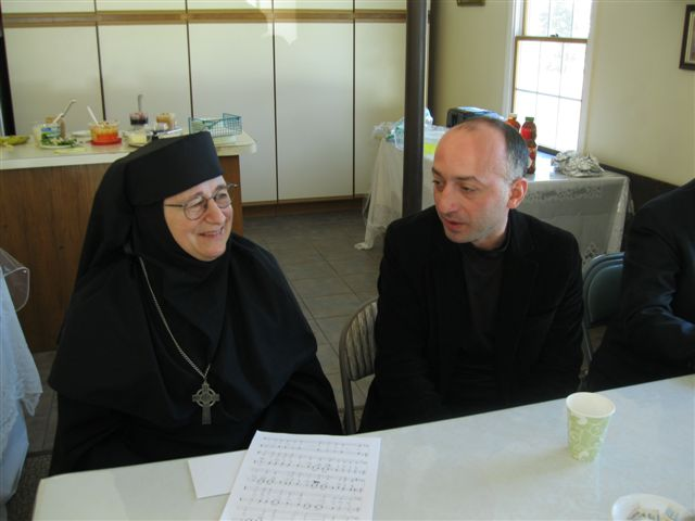 After Liturgy the next day, Mother compares notes with our choir director Lasha.