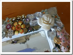 startings of a bejewelled mirror