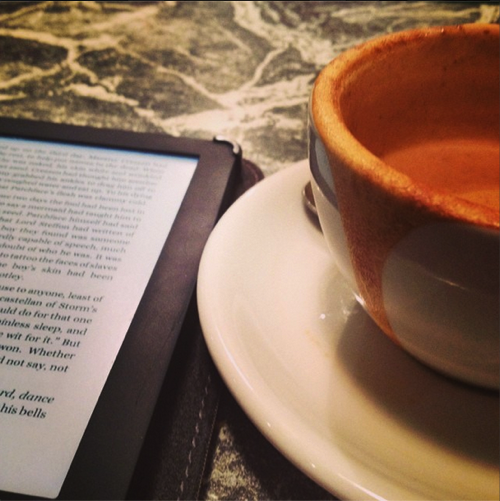 Cup of coffee and a book