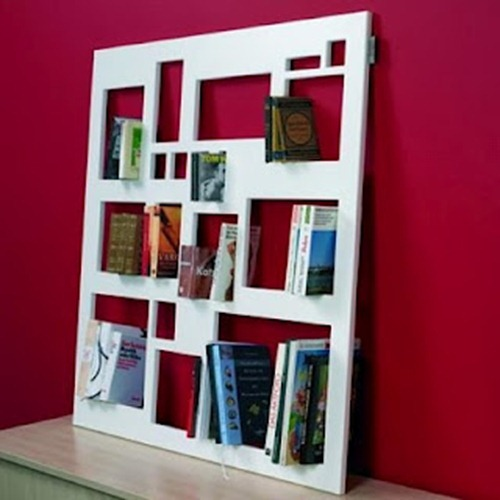 Livros em painel vazado
