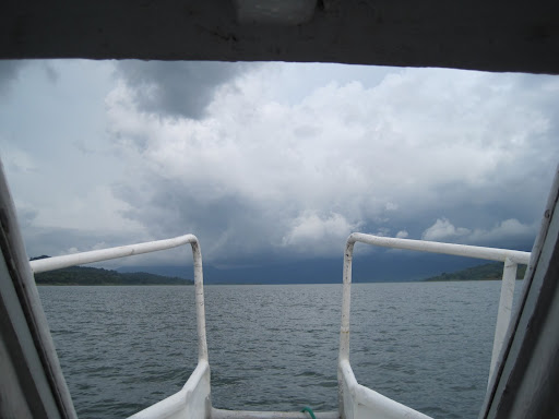 Ominious skies threatening lightning as we cross Laguna de Arenal