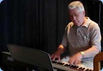 Jim Nicholson playing the Club's Korg SP-250 digital piano. Photo courtesy of Dennis Lyons