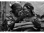 Two Congolese women reunite in Kibati Internally Displaced persons' camp, where tens of thousands live, North Kivu, DR Congo. <em>© Kate Geraghty</em>