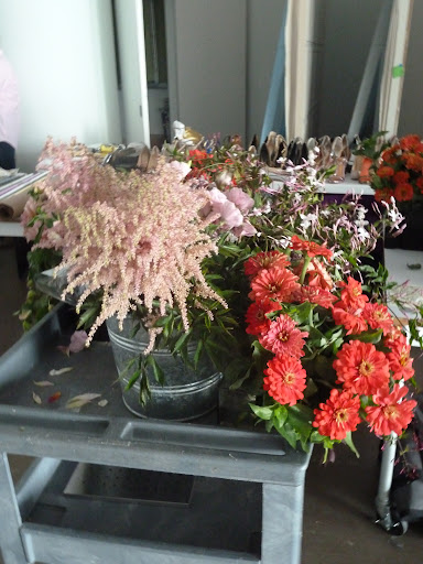 Another cart of flowers, including astilbe and zinnias.