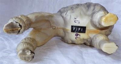 plastic poodle figurine underside