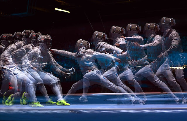 A multiple exposure picture taken at the ExCel centre in London shows fencer fighting during a Men's Sabre fencing bout as part of the London 2012 Olympic games.