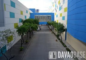 The bridge linking SM City Davao to The Annex is located above the mall compound's pathways