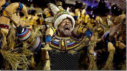 A performer from the Portela samba school parades at the Sambadrome in Rio de Janeiro. (Victor R. Caivano/Associated Press)
