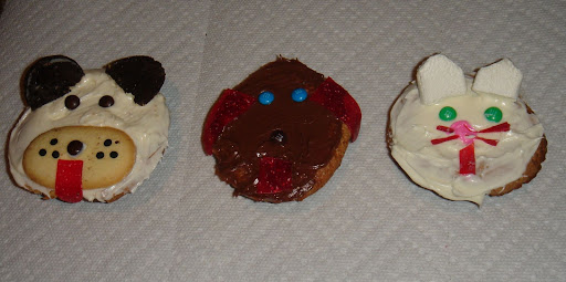 CHILD'S PLAY:  Sonya Fitzpatrick, host of Animal Intuition on Sirius XM Stars,  teamed up with her 7 yr old daughter Emily to create cupcakes of their furry friends. The chocolate dog is a representation of their newly adopted dog Lucky.