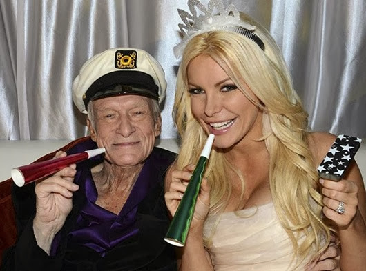 Octogenarian Playboy founder Hugh Hefner poses with his bride Crystal Harris as they ring in the new year at their wedding in Beverly Hills...Octogenarian Playboy founder Hugh Hefner poses with his bride Crystal Harris as they ring in the new year at their wedding at the Playboy Mansion in Beverly Hills, California in this handout photo taken on December 31, 2012. Hefner briefly swapped his iconic silk pajamas for a tuxedo to marry Harris, the one-time