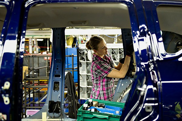A Chrysler Group LLC employee works on a 2012 Jeep Compass on the production line at the company's assembly plant in Belvidere, Illinois, 2 February 2012. Daniel Acker / Bloomberg / Getty Images