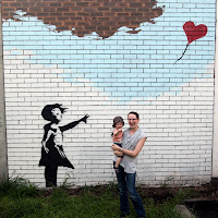"""Kristy and Oscar in front of the """"Banksy"""""""