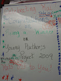 Kai's classmates signed the board congratulating him for his winning entry in the Young Authors' Project
