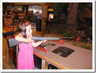 Practicing her aim at Bass Pro