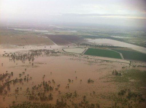 This aerial photo, taken with an iPhone, shows an extensively flooded area in the New South Wales town of Moree, on 3 February 2012. More than 10,000 Australians have been stranded by flooding in the country's east, with thousands ordered to leave their homes or businesses and the military called in to airlift supplies. AFP